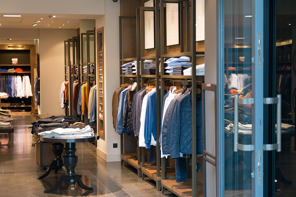 upscale retail store with racks of collared shirts