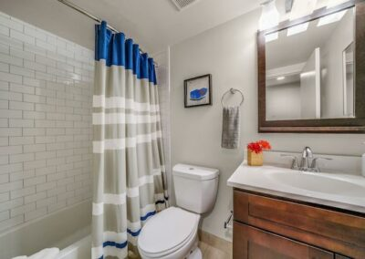 Model bathroom with shower tub, toilet and vanity sink at Sharples Works apartments in West Chester, PA.