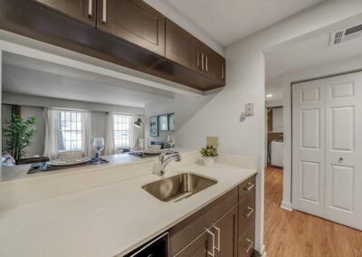 Model kitchen with spacious counters and breakfast bar at Sharples Works Apartments in West Chester, PA.