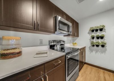 Model kitchen with modern stainless steel appliances at Sharples Works Apartments in West Chester, PA.
