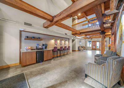 Lobby coffee bar with beamed ceiling and ample seating at Sharples Works' luxury apartments in West Chester.